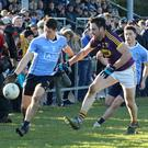 Sportsfile photographer Matt Browne has one of the best views in the house as Daithí Waters tries to halt the progress of Dublin's David Devereux