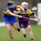 Wexford match winner Linda Bolger under strong pressure from Tipperary defender Mary Ryan. ©INPHO/Bryan Keane