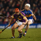 Paul Morris under pressure from Tipperary defender Seán O'Brien. Photo by Stephen McCarthy/Sportsfile