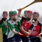 Niamh Ogilvie of St. Mary's battling for the ball with Clodagh Carroll (St. Angela's)