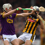 Wexford's Cathal Dunbar putting pressure on Kilkenny full-back Pádraig Walsh