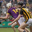 Rory O'Connor, the one bright light for Wexford, trying to get away from Kilkenny goalscorer Walter Walsh.