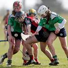 Aisling Prendergast and Cria Langton of St. Mary's apply pressure on St. Angela's captain Abby Flynn.