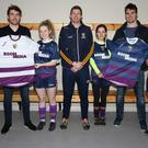 Rob Tierney and Michael O'Regan of Boom Media presenting training tops to Wexford ladies' footballers Ciara Ryan, Cailín Fitzpatrick, Ellen O'Brien, Niamh Mernagh and team manager Anthony Masterson.