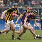 Jack O'Connor has support from Diarmuid O'Keeffe as he gets to the ball before Kilkenny attacker John Donnelly.