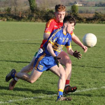 Eoin Ryan of Gusserane is chased by Dillon Redmond (Starlights)