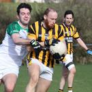 Aidan Cash (Shelmaliers) is tackled by Shane Murphy of St. James' during Saturday's clash