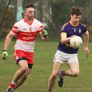 Michael O' Brien of St. Patrick's on the move with Kilanerin's Liam Carroll in hot pursuit.