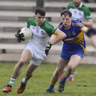 Brian Molloy of St. James' breaking away from Gusserane's Mark Rossiter during Saturday's clash in O'Kennedy Park, New Ross