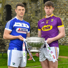 Wexford's Naomhan Rossiter with John O'Loughlin of Laois at the Leinster championship launch in Trim Castle, Co. Meath