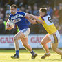 Donie Kingston, the chief Laois dangerman, holds off Naomhan Rossiter. Wexford wore special retro-style jerseys to mark the centenary celebrations of the All-Ireland winning 1915 to 1918 football teams. Photo by Matt Browne/Sportsfile