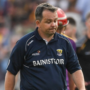 A dejected Davy Fitzgerald leaving the field along with Aidan Nolan after Saturday's one-point defeat.