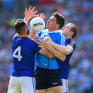 Paddy Andrews of Dublin in action against Diarmuid Masterson and Patrick Fox of Longford during the Leinster Senior football championship semi-final in Croke Park. Photo by Stephen McCarthy/Sportsfile