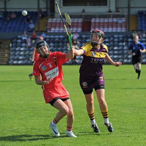 A midfield battle between Shelley Kehoe and Cork's Julia White. Photograph: George Hatchell