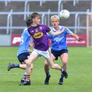 Wexford's Lee Nolan tries to keep the ball away from Euan Farquharson of Dublin