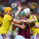 Galway attacker Evan Niland has nowhere to go as Wexford duo Damien Reck and Rory O'Connor close him down