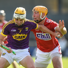 Wexford defender Ian Carty holding off Declan Dalton of Cork during Saturday's heavy defeat in Nowlan Park