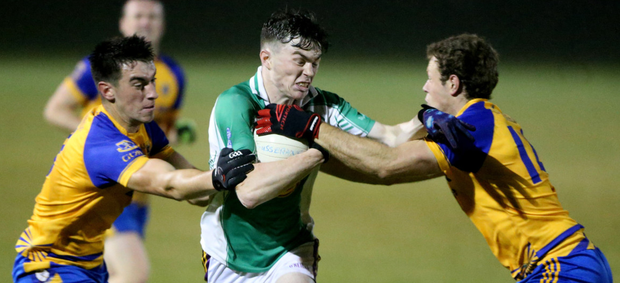 Stephen O'Gorman of Taghmon-Camross under pressure from Gusserane's John Roche and Cillian Kehoe in the Tom Doyle Supplies SFC game in Horeswood on Friday
