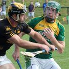Lorcan French (Adamstown) and Matty Byrne (HWH-Bunclody) in a battle for the ball