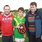 Sebastian Veal with Brian Carty, representing People Newspapers, and David Tobin of Coiste na nOg