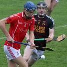 Man of the match Daire Barden racing away from Cathal McCabe