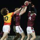 Ben Maddock and Eoin O'Leary of St. Martin's outnumbering David Gouldson (Sarsfields) two to one