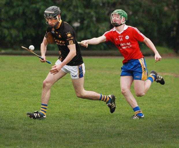 Shane Doyle of Munna Abbáin Gaels tries to avoid Ben O'Connor