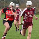 Ella O'Connor (St. Martin's) racing away from Siobhán Sinnott