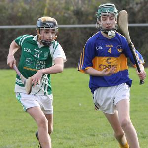Diarmuid Roche of St. Mary's is pursued by Joshua Botha