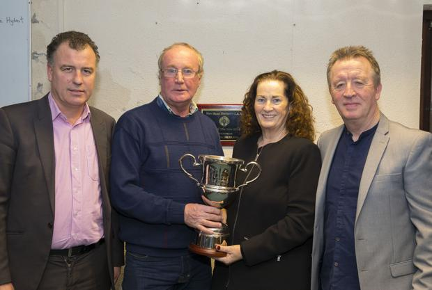 Seamus Cullen receiving the Paddy Kehoe Perpetual Memorial Trophy for Gusserane G.A.A. clubperson of the year from Paddy's daughter, Julie, accompanied by her husband, Jackie Roche (right), as club Chairman Cllr. Michael Whelan looks on
