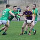 Impressive Wexford midfielder Niall Hughes is outnumbered by Meath trio Darragh Campion, Gavin McCoy and Michael Newman
