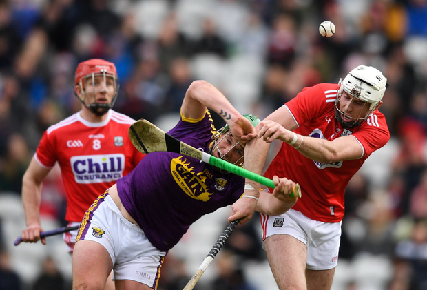 Conor McDonald in a clash with Cork defender Tim O'Mahony