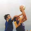 The late John Harrington making a trademark clean catch over the head of Longford's David Hanniffy in the Leinster Senior football championship in Pearse Park, Longford, on May 16, 1999 - the last of his 112 Senior appearances for Wexford