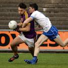 Conor Devitt of Wexford under pressure from Jack Mullaney (Waterford)