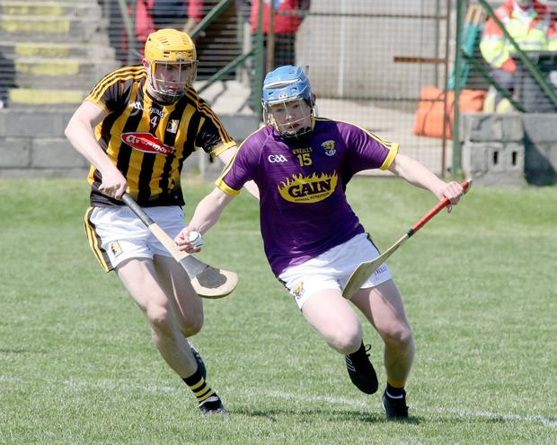 Corner-forward Cian Byrne going for goal as Tristan Roche moves in