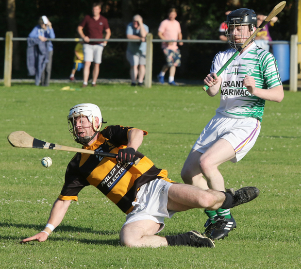 Rathnure's Brendan O'Leary takes a tumble under pressure from Floyd Murphy (Shamrocks)
