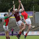 Ben Maddock battles in the air with Brian Ronan and Liam Ryan