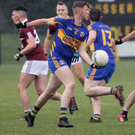 Gusserane centre-back MarkO'Neill seeking a colleague with a handpass in their 0-17 to 0-4 loss to Castletown last April