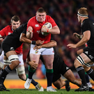 Tadhg Furlong is tackled by Jerome Kaino and Codie Taylor of New Zealand.