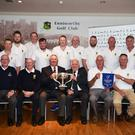 Back (from left): Declan Byrne, Denis Dunne, James Foley, Eddie Doyle, Davie Murphy, Seán Hegarty, Jim Mackey, Willy Dobbs, Eunan Doyle, Joe Murphy, Shane Fortune. Front (from left): John Cullen (Leinster Provincial Council delegate and Championship Convenor), Jim Hogan (club President), Jack Murphy (club Captain), John Ferriter (Chairman of Leinster Branch of G.U.I.), club Vice-Captain Tim Morrissey and John Byrne, the team managers, proudly holding the all-important pennant.