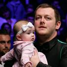 Mark Allen celebrates with his daughter after beating Kyren Wilson in the final of The Masters. (Photo by Tai Chengzhe/VCG via Getty Images)