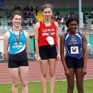 Aisling Kelly (centre) on the podium at the All-Ireland Loreto Schools Sports Day in Santry