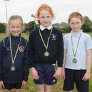 The Under-8 80m girls' medal winners on day two (from left): Kayleigh Butler (Caroreigh, silver), Josie O'Brien (Blackwater, gold) and Emily Murphy (Kilmuckridge, bronze)