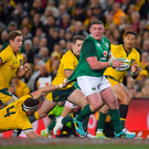 Izack Rodda of Australia attempts to stop Tadhg Furlong in his tracks in Sydney on Saturday. Photo by Brendan Moran/Sportsfile