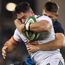 Dylan Fawsitt of the U.S.A. is tackled by Ireland's Ross Byrne in the Aviva Stadium on Saturday