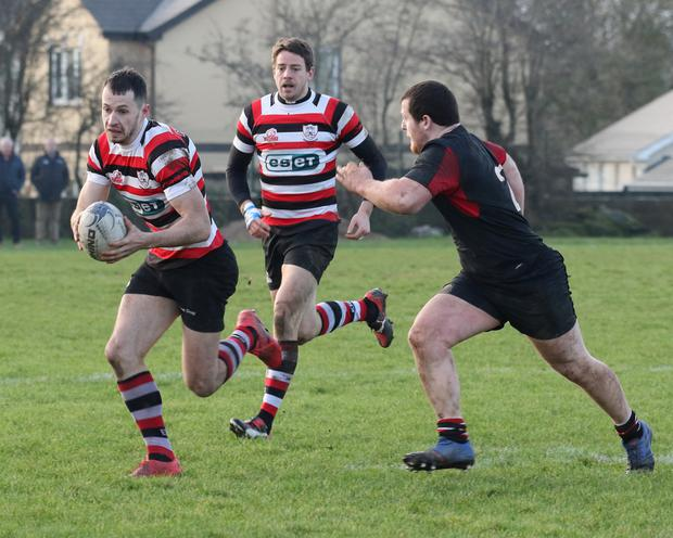 Enniscorthy's Ivan Jacob is pursued by Luke Gersekowski of Wicklow.