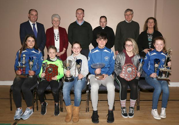 At the Bree AC awards night in Bree Community Centre were, front: Sophie Codd (U17), Jayden Kenny (U10), Leah Bolger (10), Darra Casey (Athlete of the Year), Olivia Howe (U19) and Abbie Doyle (U13). Back: Paul Kehoe, Chare Doyle (secretary), William Spratt-Murphy (chairman), Fr. Billy Caulfield, Pat O'Leary and Breda Cahill