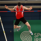 Michael Bowler on his way to securing gold in the pole vault in Abbotstown