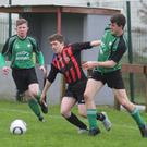 James Barron of New Ross Celtic is flanked by Crossabeg duo Andy Butler and Conor Maddock