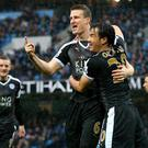 Robert Huth celebrates with Shinji Okazaki after scoring Leicester's first goal against Manchester City